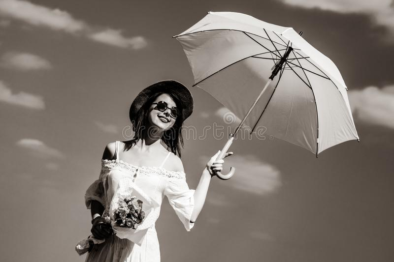 Young woman with bouquet and umbrella royalty free stock photos
