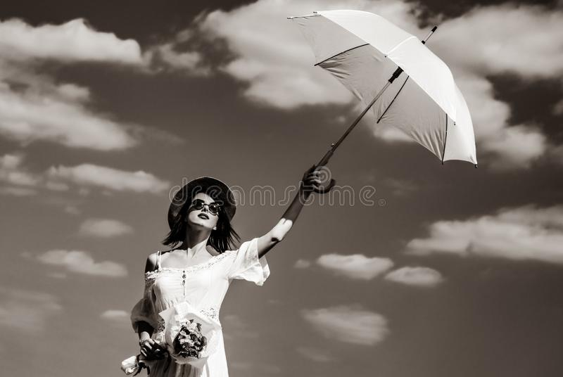 Young woman with bouquet and umbrella royalty free stock image