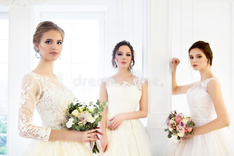 Young woman with bouquets wearing wedding dresses royalty free stock photo