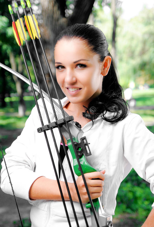 Young woman with a bow and arrows royalty free stock image