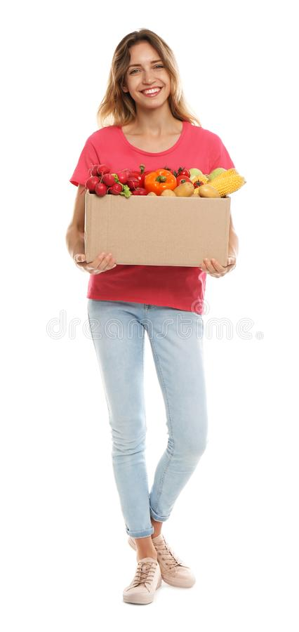 Young woman with box of fresh vegetables on white stock photos