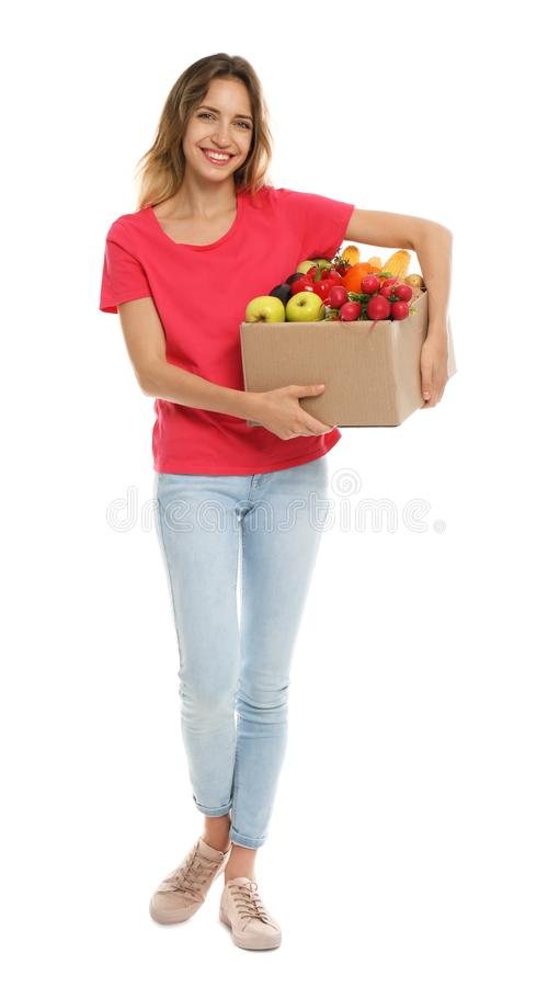Young woman with box of fresh vegetables royalty free stock image