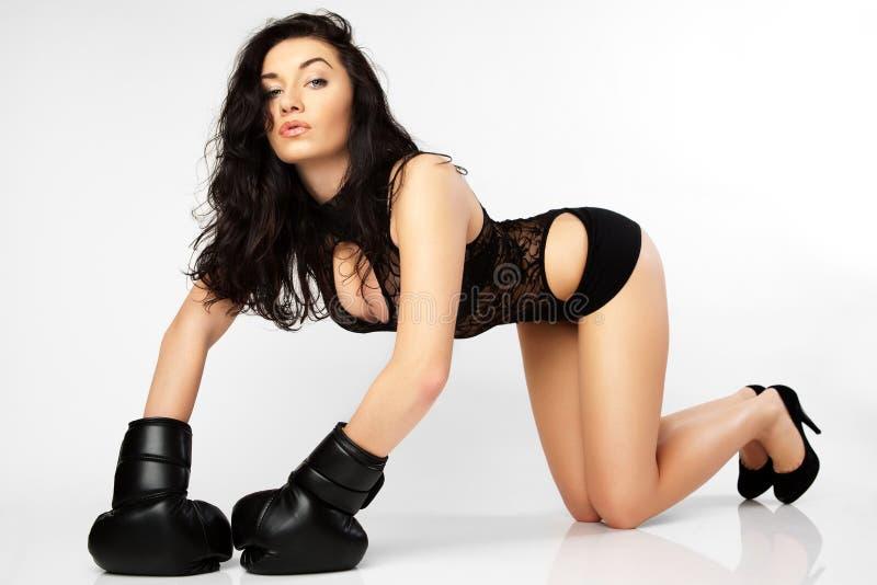 A young woman boxer. stock photos