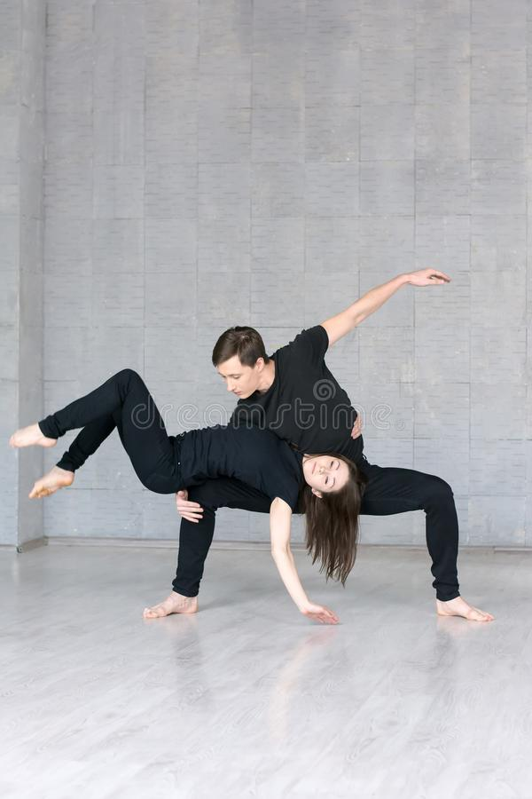 Young woman and boy posing in dance. stock photos