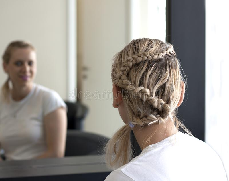 Young woman with braided hairstyle stock photos