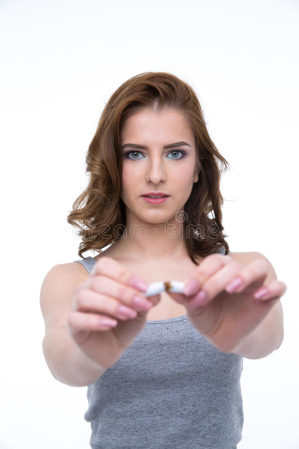 Young woman breaking cigarette royalty free stock photography