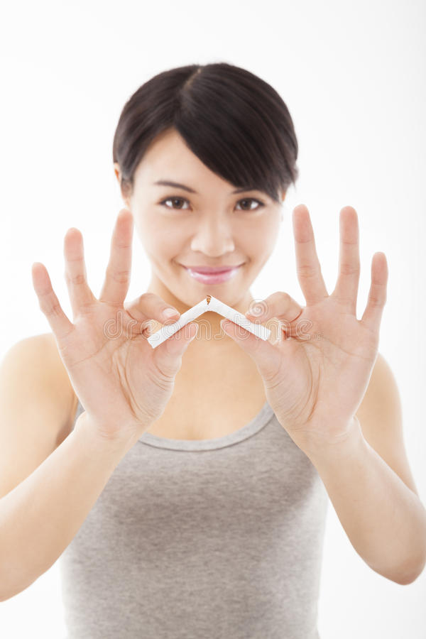 Young woman breaking cigarette. And stop smoking concept royalty free stock images