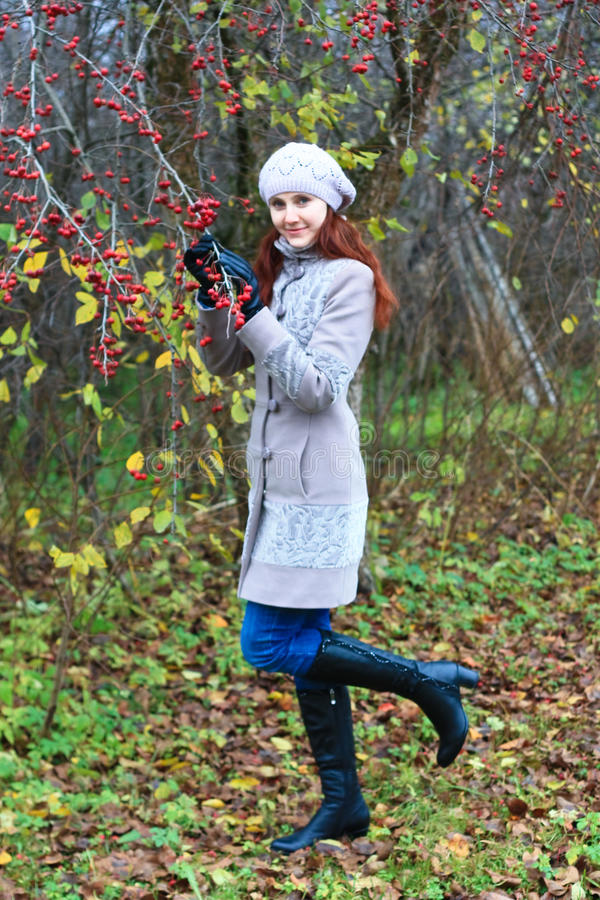 Young Woman In The Bright Autumn Colors Royalty Free Stock Image