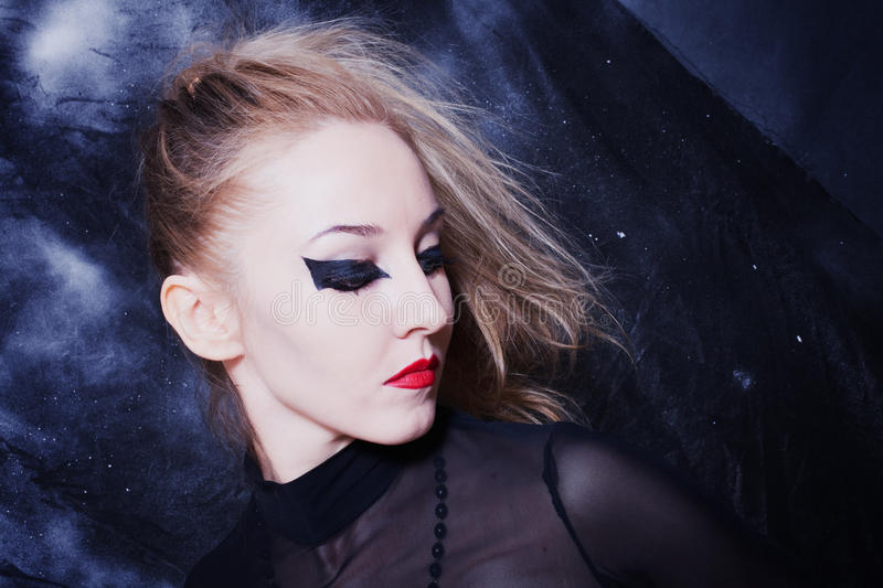 Young woman with bright gothic makeup closeup. Portrait of beautiful young woman with bright gothic makeup royalty free stock photography