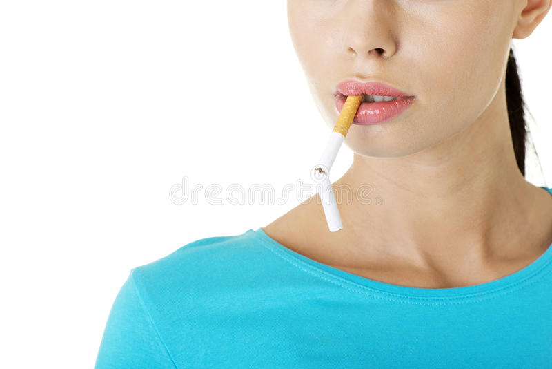 Young woman with broken cigarette. Stop smoking concept royalty free stock photos
