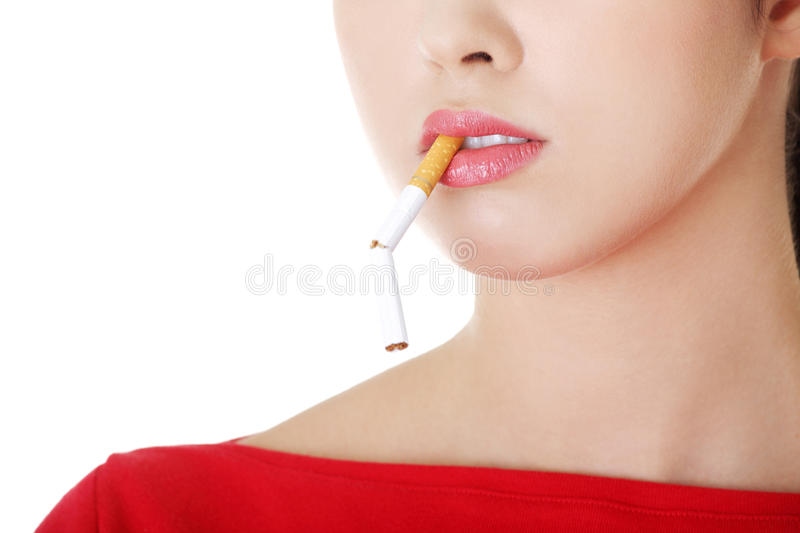 Young woman with broken cigarette. Stop smoking concept stock images