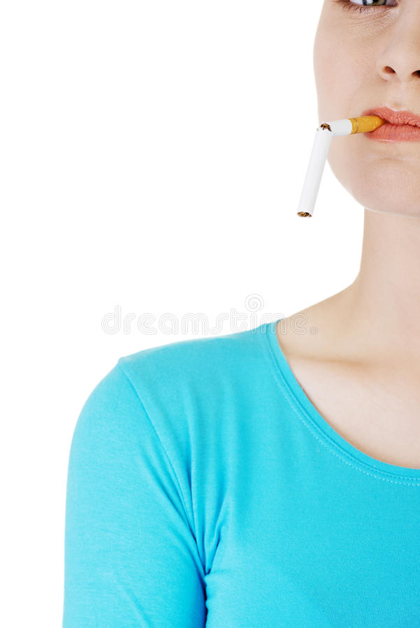 Young woman with broken cigarette. Stop smoking concept royalty free stock photo
