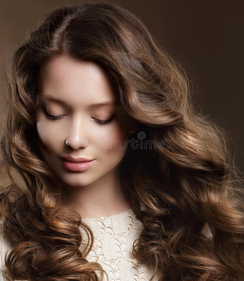 Young Woman with Brown Hair in Reverie stock image