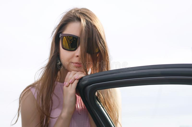 Woman near car door. royalty free stock photography