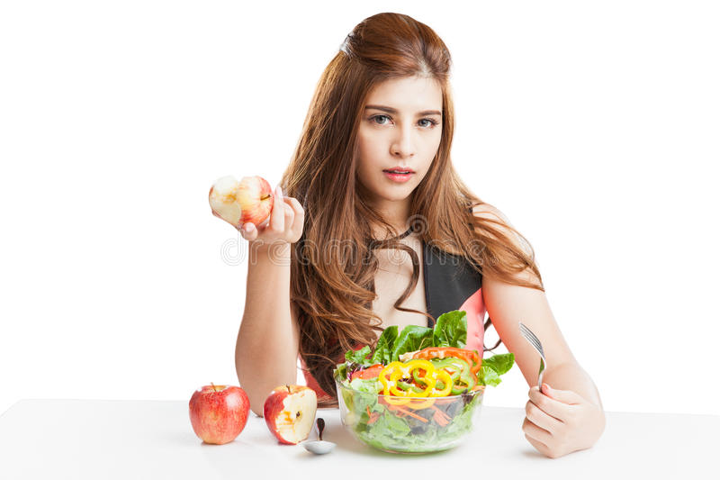 Young woman brunette present and eating salad stock images