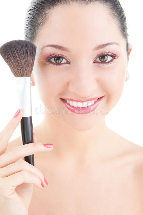 Young woman with brush for makeup. Isolated on white background royalty free stock photo