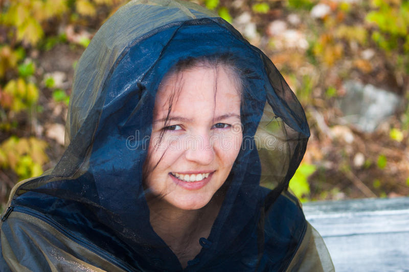 Young woman in bug gear stock image
