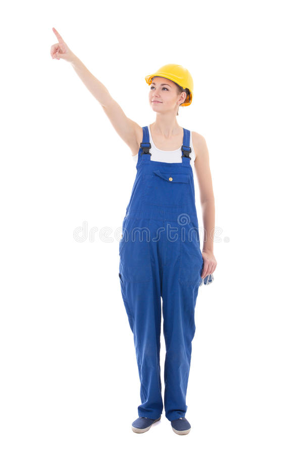 Young woman builder pointing at something isolated on white stock photos