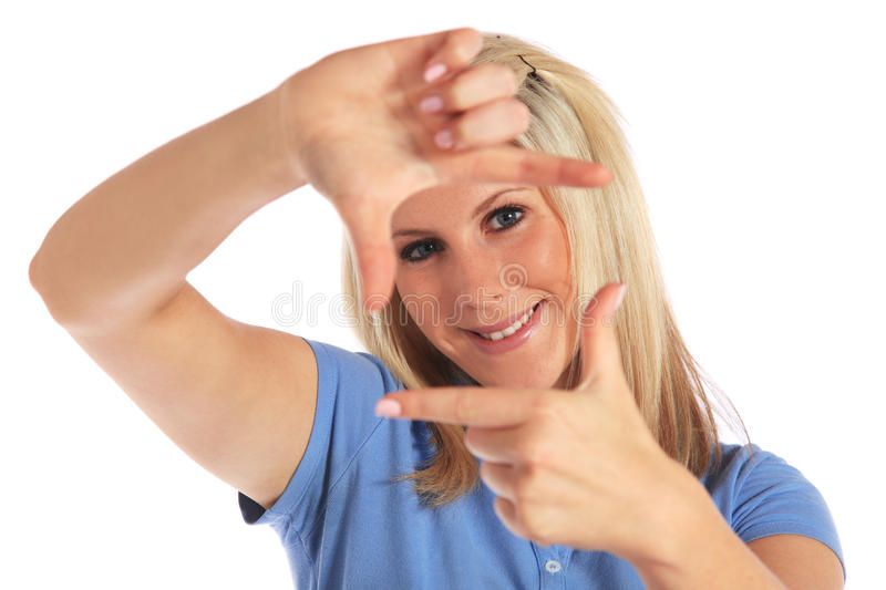Young woman building a frame out of her hands royalty free stock photo