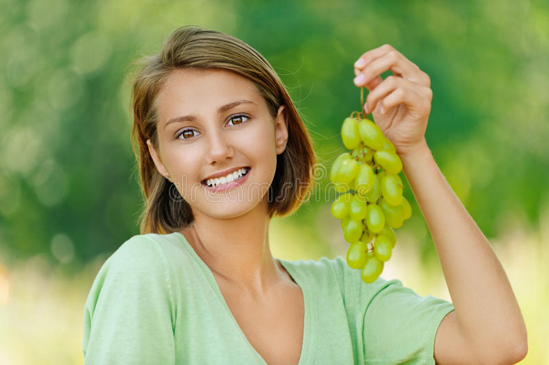 Young Woman With Bunch Of Grapes Royalty Free Stock Image