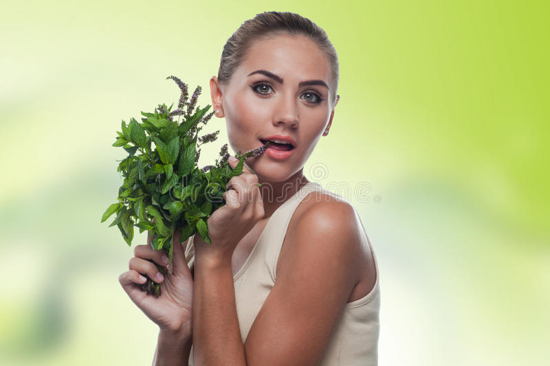 Young woman with with a bundle of fre royalty free stock photography