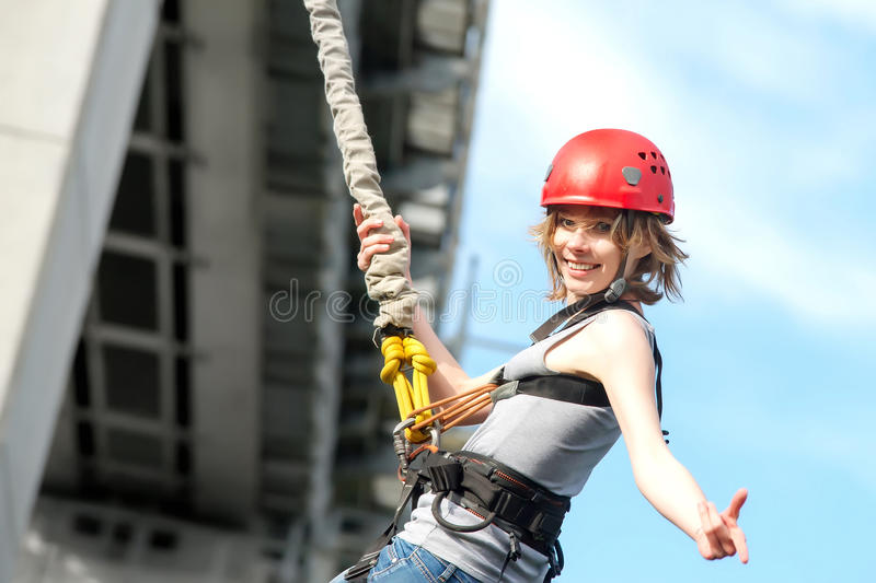Young woman after the bungee jump stock photos