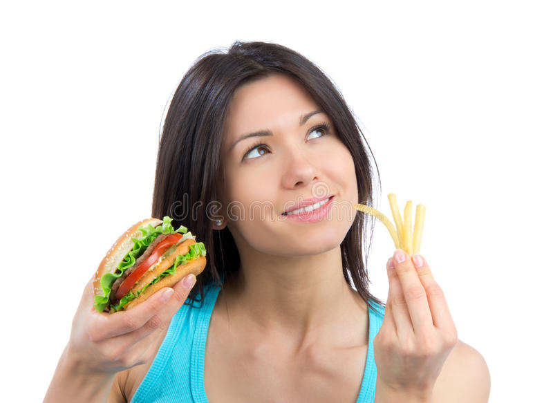 Download Young Woman With Burger And French Fries Stock Photo - Image: 24610398