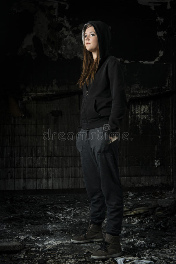 Young woman in a burned house royalty free stock image