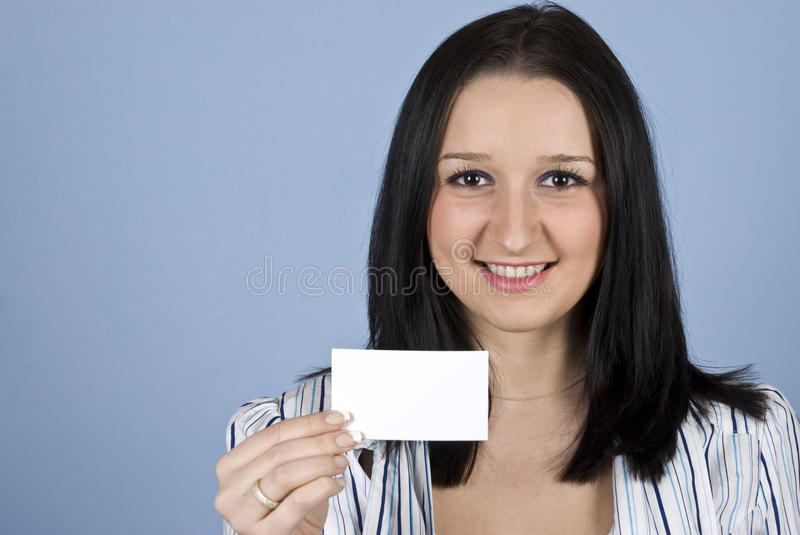 Young woman with business card royalty free stock image