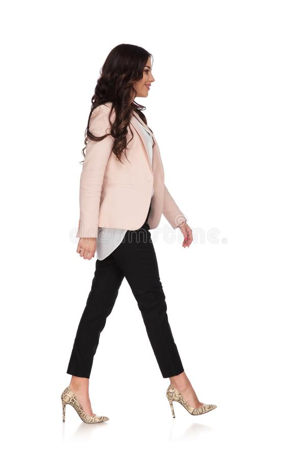 Young woman in business clothes is walking and smiles stock photos