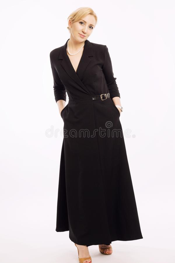 Young woman in business dress in full growth stock photos