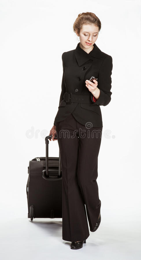Young woman in a business suit with trunk stock photo
