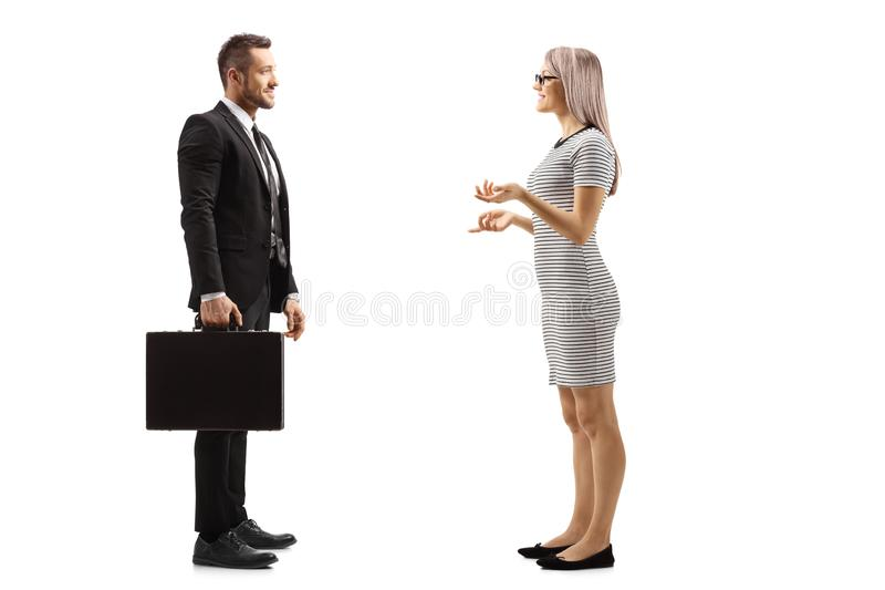 Young woman and businessman having a conversation royalty free stock photography