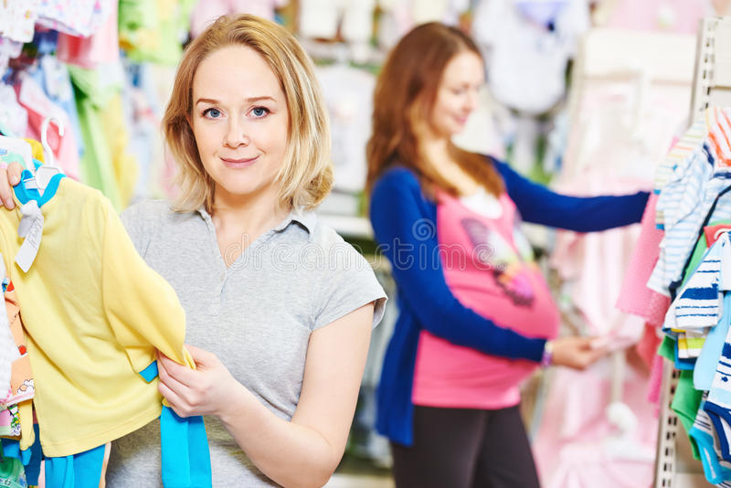 Young woman buyers shopping during pregnancy stock photography