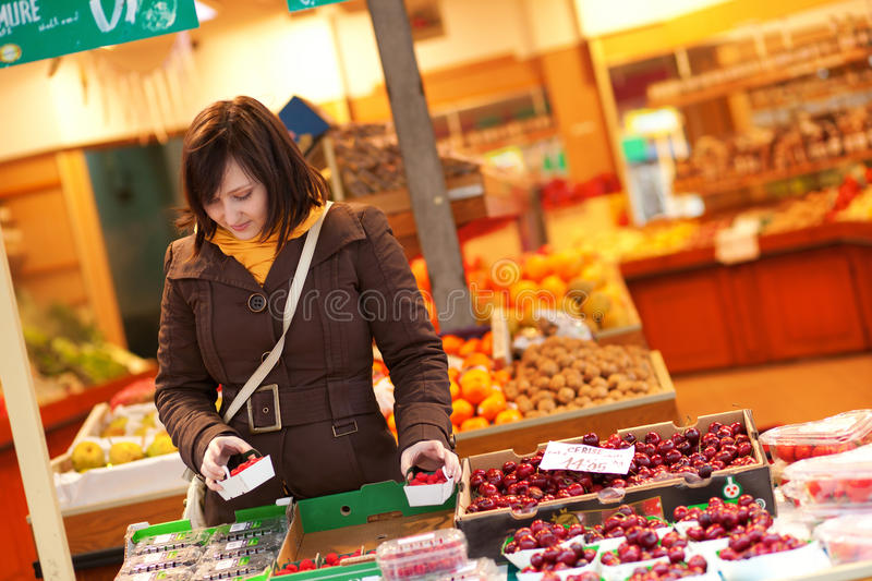 Young Woman Buying Fruits At Market Stock Photography