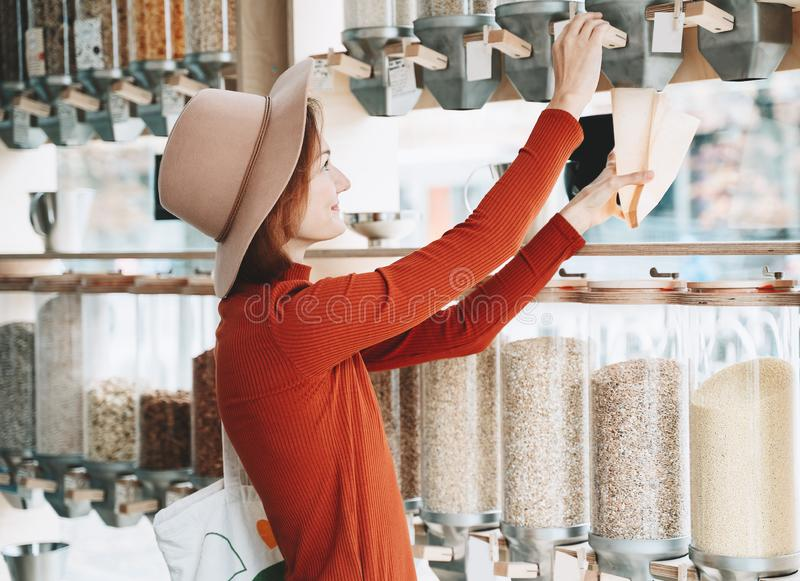 Young woman buying in plastic free grocery store royalty free stock photography
