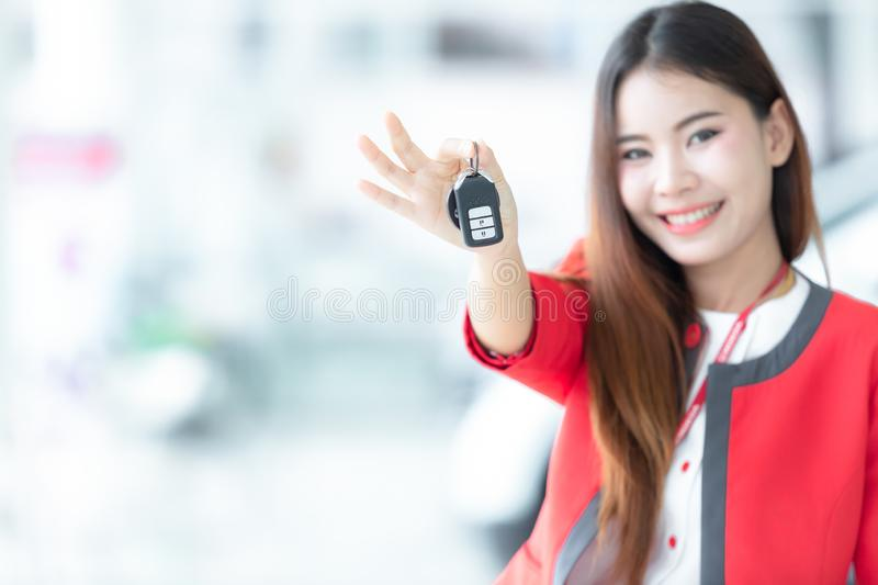 Young woman buys a car with receiving the keys of her new car, P stock images