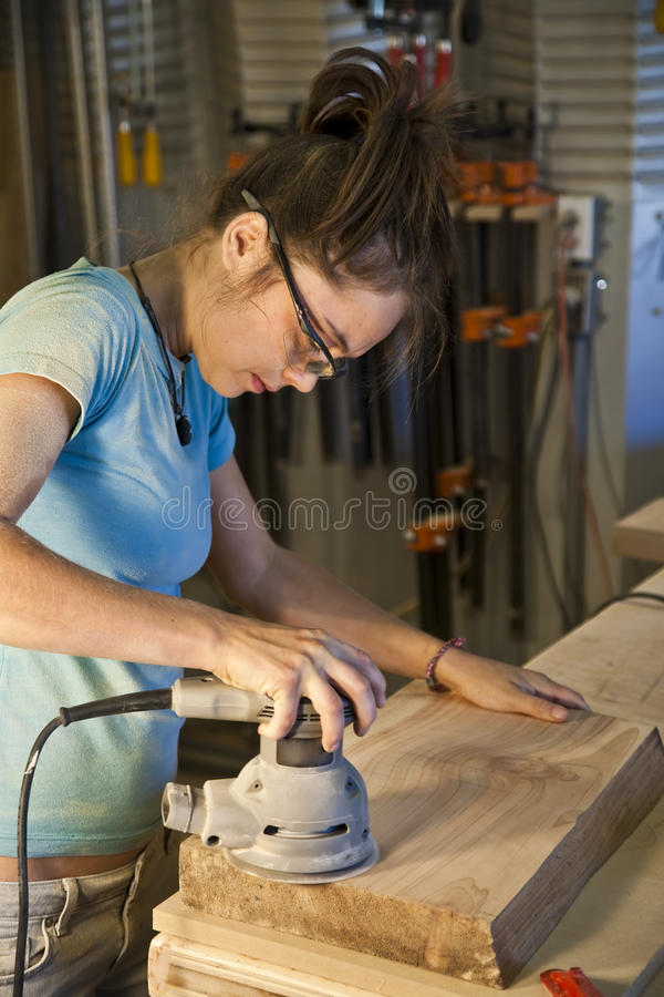Free Young Woman Cabinet Making. Stock Photos - 12010953
