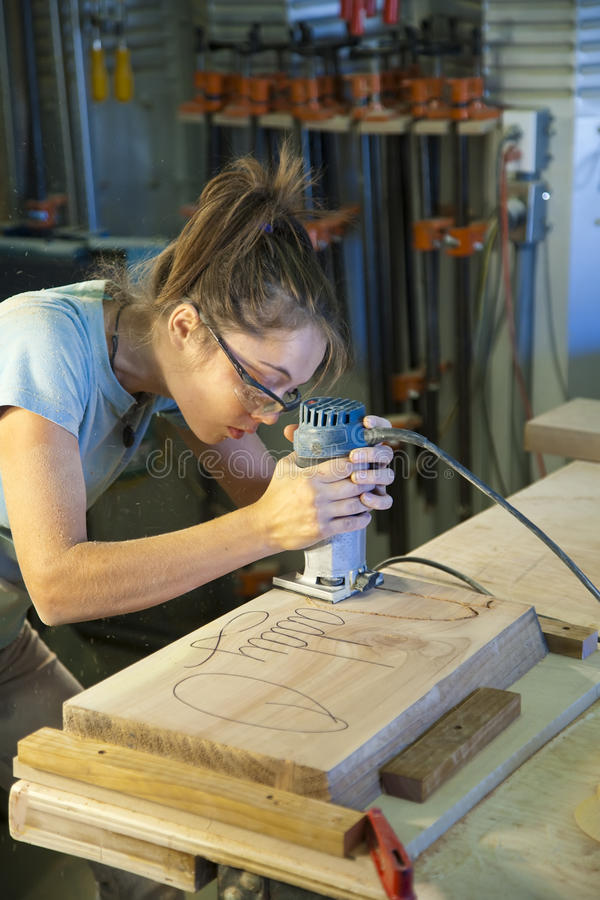 Download Young Woman Cabinet Making. Stock Photography - Image: 12014202