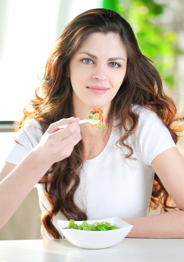 Download A Young Woman In A Cafe With A Coffe With Salad Stock Image - Image: 20731091