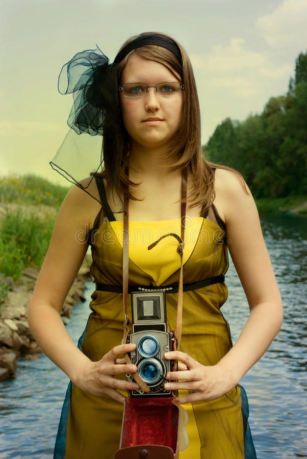 Download Young woman with camera stock photo. Image of self, posed - 22053728