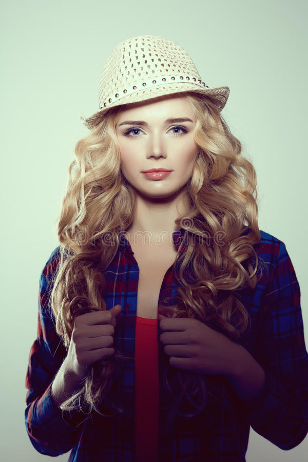 Young woman with camera. Blonde in a plaid shirt. Hipster fashion photographer girl. Young people, youth culture stock images