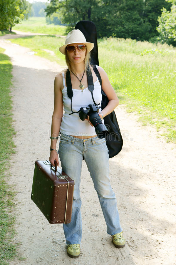 Young Woman With Camera And Suitcase Royalty Free Stock Image