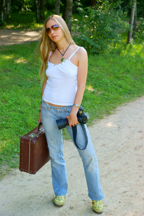 Download Young Woman With Camera And Suitcase Stock Photo - Image: 14754886