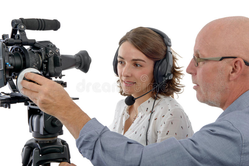 Young woman cameraman and the mature man. Beautiful young women cameraman, and the mature man royalty free stock photography