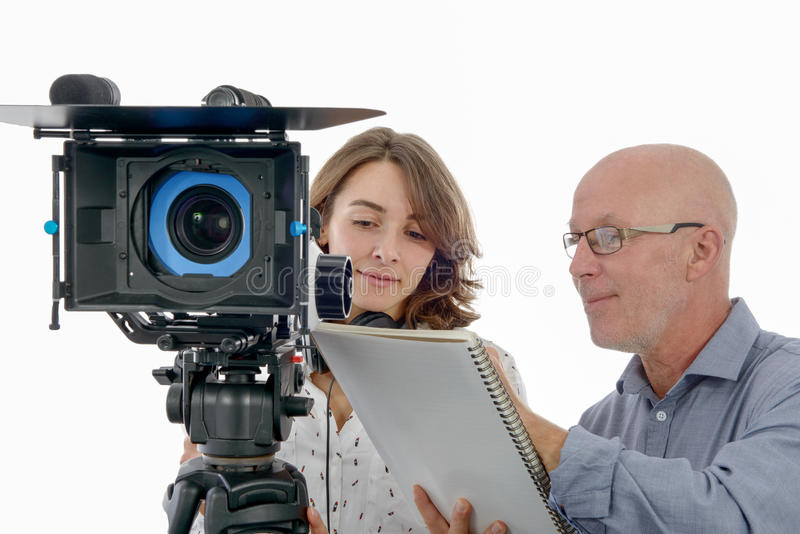 Young woman cameraman and the mature man. Beautiful young women cameraman, and the mature man royalty free stock photo