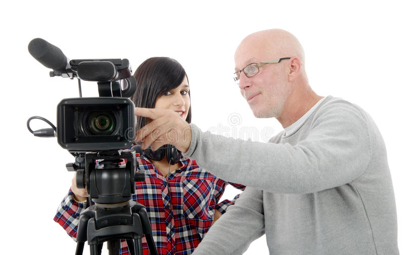 Young woman cameraman, and the mature man. Young brunette women cameraman, and the mature man royalty free stock images