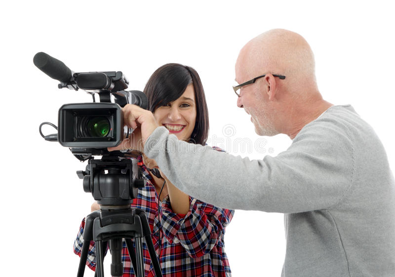 Young woman cameraman, and the mature man. Young brunette women cameraman, and the mature man stock images