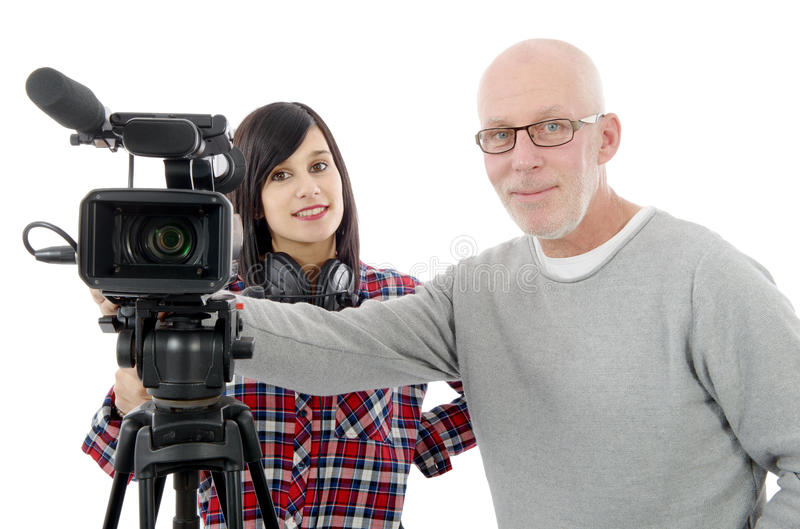 Young woman cameraman, and the mature man. Young brunette women cameraman, and the mature man stock photo