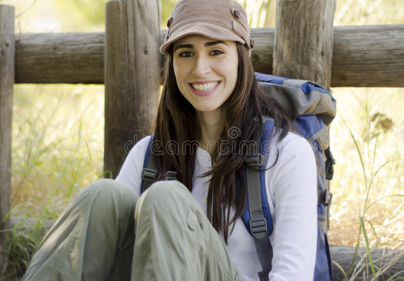 Young woman on camping trip. Portrait of a young beautiful woman on a camping trip stock photo